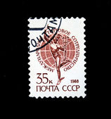 UNION OF SOVIET SOCIALIST REPUBLICS - CIRCA 1988: A stamp printed in the USSR shows image of a person and the Earth, series, circa 1988 — Stock Photo