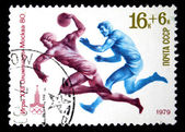 "USSR - CIRCA 1979: stamp printed in the USSR (Russia) shows Olympic emblem and basketball with the inscription and name of series ""Olympic Games, Moscow - 80"", circa 1979 — Stock Photo"