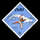 CUBA - CIRCA 1965: A stamp printed in Cuba shows competition in high jump, circa 1965 — Fotografia Stock