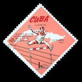 CUBA - CIRCA 1965: A Stamp printed in Cuba shows competition in Hurdling, circa 1965 — Stock Photo
