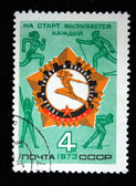 USSR - CIRCA 1973: A stamp printed in the USSR shows Icon Honors motion Ready for work and defense against the figures of athletes, circa 1973 — Stock Photo