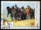 "USSR - CIRCA 1969: A stamp printed in the USSR shows a painting ""Barge haulers Along the Volga"" with the same inscription from the series ""125th Birth Anniversary of Ilya Repin "", — Stock Photo"