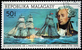 REPUBLICA MALAGASY - CIRCA 1976: A stamp printed in Madagascar shows Lafayette and ships Lexington and HMS Edward, circa 1976 — Stock Photo