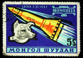 MONGOLIA - CIRCA 1980s: A stamp printed in Mongolia shows Laika - first dog in space, circa 1980s — Stock Photo