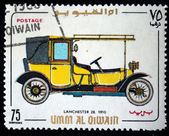 UMM AL QIWAIN - CIRCA 1968: A stamp printed in one of the emirates in the United Arab Emirates shows vintage car Lanchester-28 - 1910 year, full series - 48 of stamps, circa 1968 — Stock Photo