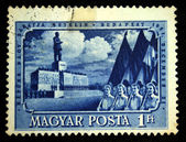 HUNGARY - CIRCA 1951: A Stamp printed in Hungary shows May Day demonstration in Budapest against the backdrop of the monument to Joseph Stalin, circa 1951 — Stock Photo