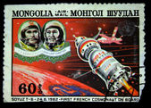 MONGOLIA - CIRCA 1982: A stamp printed in Mongolia shows members of crew Soyuz T-6 Patrick Baudry first french Cosmonaut and commander Vladimir Dzhanibekov, circa 1982 — Stock Photo