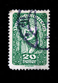 AUSTRIA - CIRCA 1925: A stamp printed in Austria shows man planing trees, circa 1925 — Stock Photo