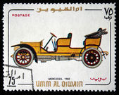 UMM AL QIWAIN - CIRCA 1968: A stamp printed in one of the emirates in the United Arab Emirates shows vintage car Mercedes - 1902 year, full series - 48 of stamps, circa 1968 — Stock Photo