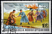 MONGOLIA- CIRCA 1977: A stamp printed in Mongolia shows Mongols extinguish the fire by passing buckets of water to each other, series, circa 1977 — Stock Photo