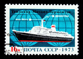 USSR - CIRCA 1973: A stamp printed in the USSR shows motor ship Mikhail Lermontov in the background of the scheme route Leningrad - New York, circa 1973 — Stock Photo