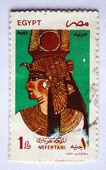 EGYPT - CIRCA 2000: A 1-pound stamp printed in Egypt shows Queen Nefertari wearing a royal headdress, circa 2000 — Stock Photo