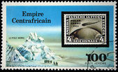 CENTRAL AFRICAN EMPIRE - CIRCA 1977: A stamp printed in Central African Empire (in present time Republic) shows old postage stamp with the image of the airship on the background of Nord Pole, circa 19 — Stock Photo