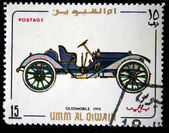 UMM QIWAIN- CIRCA 1968: A stamp printed in one of the emirates in the United Arab Emirates shows vintage car Oldsmobile - 1910 year,full series - 48 of stamps, circa 1968 — Stock Photo