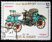 UMM AL QIWAIN- CIRCA 1968: A stamp printed in one of the emirates in the United Arab Emirates shows vintage car Opel - 1900 year, full series - 48 of stamps, circa 1968 — Stock Photo