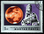HUNGARY - CIRCA 1974: A Stamp printed in Hungary shows monitoring Mars with the Palomar Observatory, circa 1974 — Stockfoto