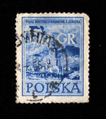 POLAND - CIRCA 1956: A stamp printed in Poland shows Palace of sciense and culture named Joseph Stalin in Warshaw, circa 1956 — Foto de Stock
