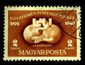 HUNGARY - CIRCA 1949: A Stamp printed in Hungary shows plane on the background of the two hemispheres of the Earth, circa 1949 — Stock Photo