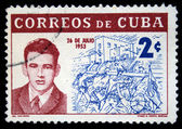 CUBA - CIRCA 1962: A stamp printed in Cuba shows portrait of Abel Santamaria on the background of assault on the Moncada barracks 26 July 1953, circa 1962 — Stock Photo