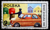 POLAND - CIRCA 1980: A stamp printed in Poland shows postman came by car takes a letters from the mailbox, circa 1980 — Stock Photo