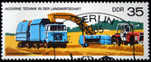 GERMANY - CIRCA 1975: A stamp printed in Germany shows pressing straw machine, circa 1975 — Stock Photo