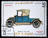 UMM QIWAIN- CIRCA 1968: A stamp printed in one of the emirates in the United Arab Emirates shows vintage car Renault — Stock Photo