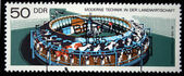 DDR - CIRCA 1975: A stamp printed in DDR (Eastern Germany) shows Rotary apparatus for milking cows, circa 1975 — Stock Photo