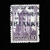 DENMARK - CIRCA 1942: A stamp printed in the Denmark shows Round Tower of Trinity Church, circa 1942 — Stockfoto