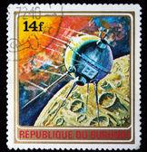 BURUNDI - CIRCA 1972: A stamp printed in Burundi shows Satilite under the Moon, series, circa 1972 — Stock Photo