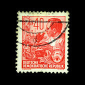 GDR - CIRCA 1958: A stamp printed in GDR (East Germany) shows scientist with a microscope, circa 1958 — Stockfoto