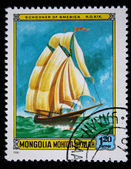 MONGOLIA - CIRCA 1981: A stamp printed in the Mongolia shows Schooner of America, one stamp from series, circa 1981 — Stok fotoğraf