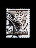 AUSTRIA - CIRCA 1930s: A stamp printed in Austria shows Seated eagle on a background of mountain peaks, circa 1930s — Stock Photo