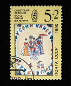 USSR - CIRCA 1990: A stamp printed in the USSR shows childrens draw Seven women watching a child playing, series devoted Sovet Childrens Fund, circa 1990 — Stock Photo