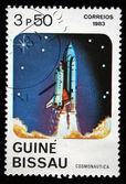 GUINEA-BISSAU - CIRCA 1983: A stamp printed in Guinea-Bissau shows Shuttle start, circa 1983 — Zdjęcie stockowe