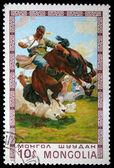 MONGOLIA - CIRCA 1975: A stamp printed in Mongolia shows taming unbroken horse, circa 1975 — Stock Photo