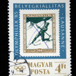 "HUNGARY - CIRCA 1975: A stamp printed in Hungary from the ""Winter Olympic Games, Innsbruck 1976"" issue shows Slalom skiing, circa 1975. — Stock Photo"