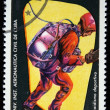 Stock Photo: CUBA - CIRCA 1974: A Stamp printed in Cuba shows skydiver jumping out of the plane door, circa 1974
