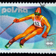 POLAND - CIRCA 1976: a stamp printed in Poland shows mountain-skier, series 12th Winter Olympic Games in Innsbruck, circa 1976 — ストック写真