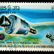LAOS- CIRCA 1985: A stamp printed in Laos shows experimental flight of Soyuz and Apollo, circa 1985 - Stock Photo