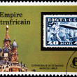 CENTRAL AFRICAN EMPIRE - CIRCA 1977: A stamp printed in Central African Empire (in present time Republic) shows old postage stamp of airship on background of St Basile Cathedrale Moscow USSR, circa 19 — Stock Photo