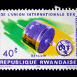 RWANDA - CIRCA 1965: A stamp printed in Rwanda commemorates the 100 year anniversary of the International Telecommunications Union. Syncom Satellite launched in 1961 by NASA, circa 1965. — Stock Photo