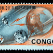DEMOCRATIC REPUBLIC OF CONGO - CIRCA 1965: a stamp from the Democratic Republic of Congo shows image of the Earth and satellites, circa 1965 - Stock Photo