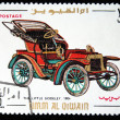 Постер, плакат: UMM QIWAIN CIRCA 1968: A stamp printed in one of the emirates in the United Arab Emirates shows vintage car The Little Siddeley 1904 year full series 48 of stamps circa 1968