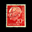 A stamp printed in Germany shows the first President of the Federal Republic of Germany Theodor Heuss, circa 1954. — Foto Stock