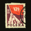 A stamp printed in Poland shows three hands with banner of Communist party of Poland, circa 1958 — Stock Photo #12170510