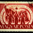 : A Stamp printed in Hungary shows three men with red banner, circa 1958 — Stock Photo #12170513