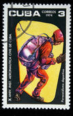 CUBA - CIRCA 1974: A Stamp printed in Cuba shows skydiver jumping out of the plane door, circa 1974 — Stok fotoğraf