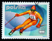 POLAND - CIRCA 1976: a stamp printed in Poland shows mountain-skier, series 12th Winter Olympic Games in Innsbruck, circa 1976 — Stock Photo
