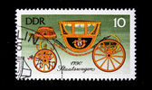 "GERMAN DEMOCRATIC REPUBLIC - CIRCA 1985: A postage stamp printed in the DDR shows image the history of horse transport, the whirlicote ""Stadtsvagen 1790"", circa 1985 — Stock Photo"