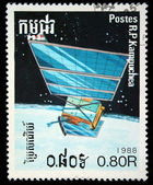 CAMBODIA - CIRCA 1988: stamp printed in Cambodia, shows space-station and planet, circa 1988. — Zdjęcie stockowe